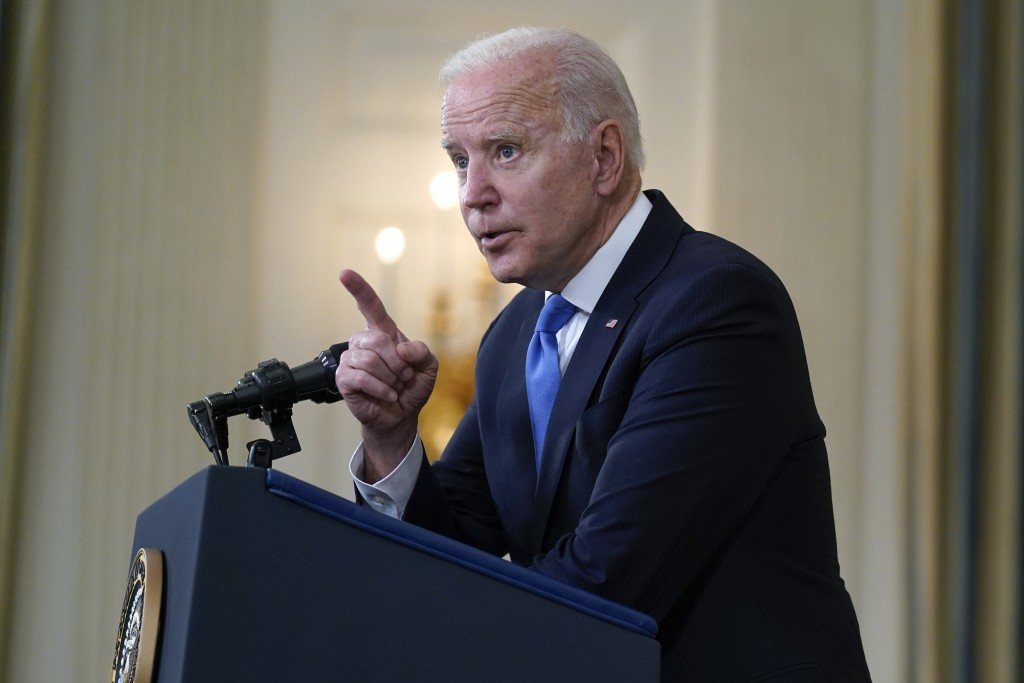 President Joe Biden takes questions from reporters as he speaks about the American Rescue Plan, in the State Dining Room of the White House, Wednesday...