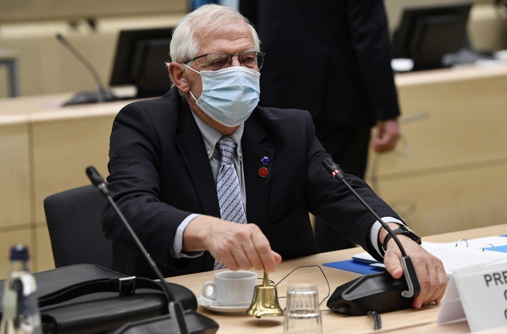 European Union foreign policy chief Josep Borrell rings a bell to signal the start of a meeting of EU defense ministers at the European Council buildi...