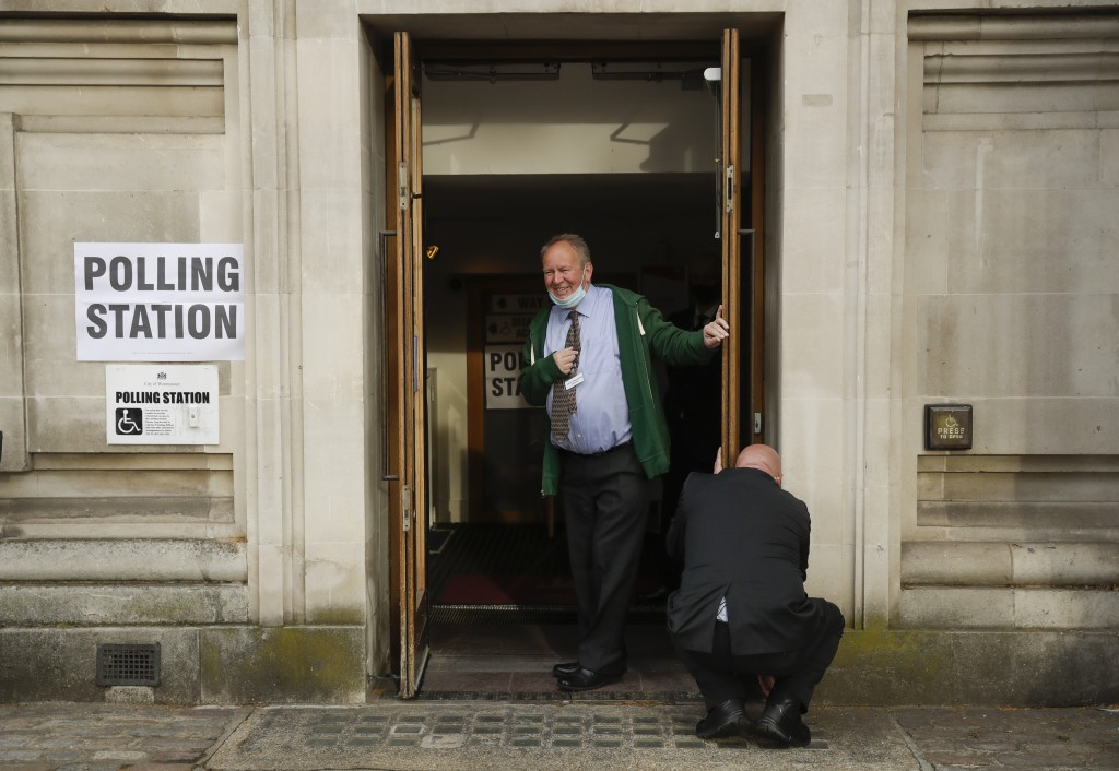 Staff open a polling station ahead of local council elections in London, Thursday May 6, 2021. Millions of people across Britain will cast a ballot on...