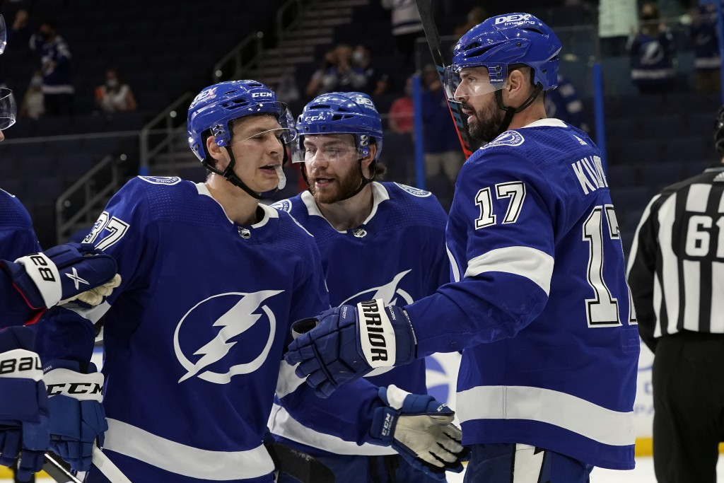 Tampa Bay Lightning left wing Alex Killorn (17) celebrates his goal against the Dallas Stars with center Yanni Gourde (37) and center Brayden Point (2...