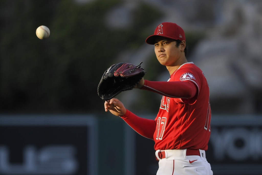 CORRECTS POSITION TO STARTING PITCHER INSTEAD OF DESIGNATED HITTER - Los Angeles Angels starting pitcher Shohei Ohtani takes the ball back from the ca...