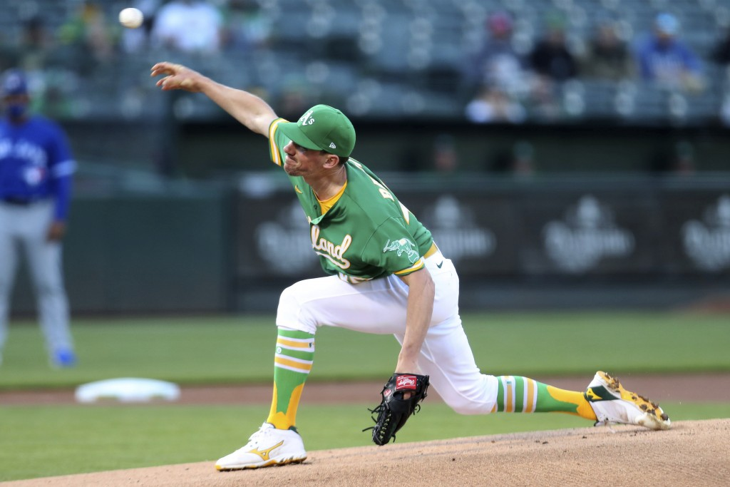 Oakland Athletics' Chris Bassitt throws to a Toronto Blue Jays batter during the first inning of a baseball game in Oakland, Calif., Wednesday, May 5,...