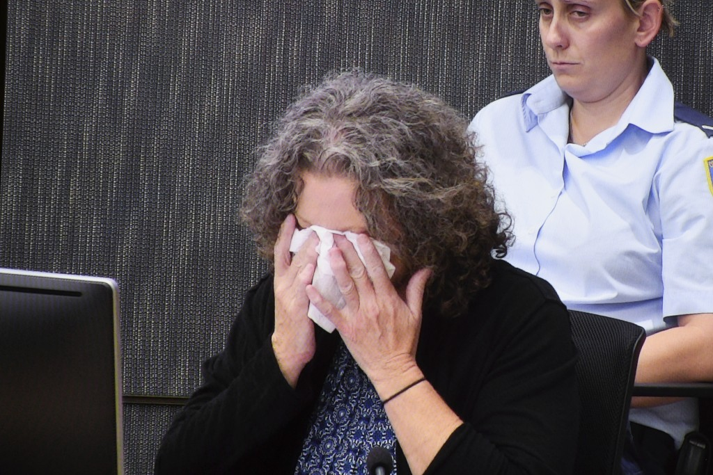 Kathleen Folbigg wipes tears away during question about the deaths of her four children as she appears via video link at the NSW Coroners Court in Syd...