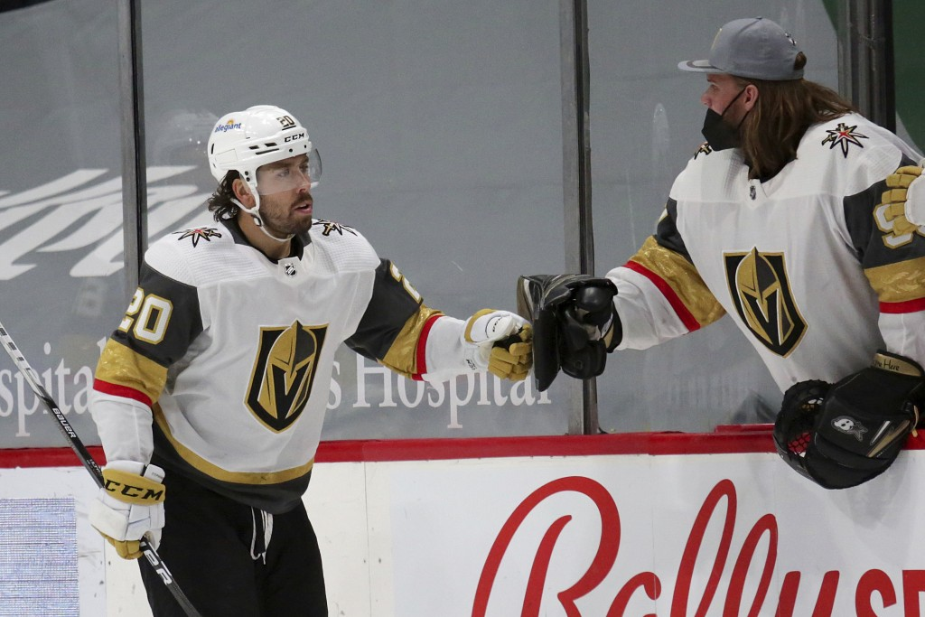 Vegas Golden Knights center Chandler Stephenson (20) is congratulated by goaltender Robin Lehner after scoring against the Minnesota Wild during the s...