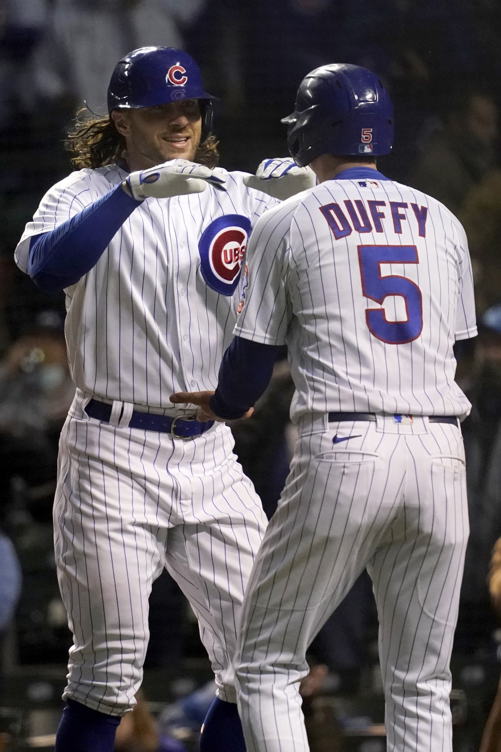 Chicago Cubs' Jake Marisnick, left, celebrates with Chicago Cubs' Matt Duffy after his two-run home run during the fifth inning of a baseball game aga...