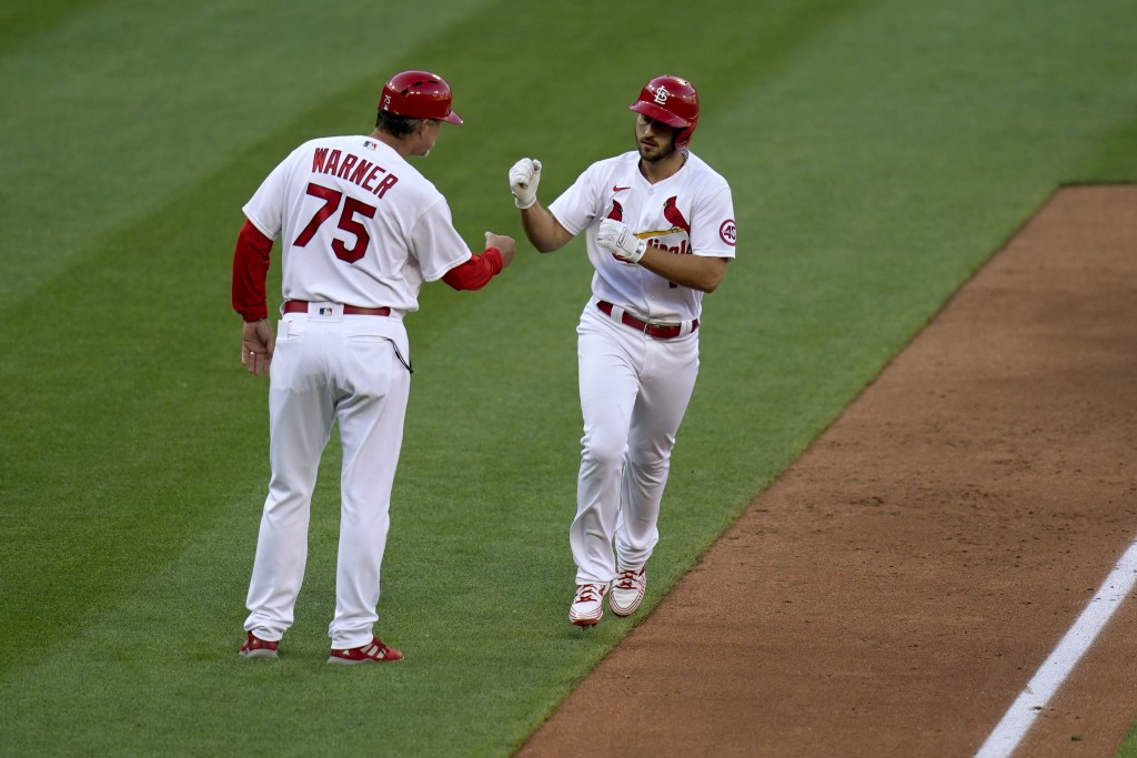 St. Louis Cardinals' Paul DeJong, right, is congratulated by third base coach Ron 'Pop' Warner (75) after hitting a two-run home run during the fifth ...
