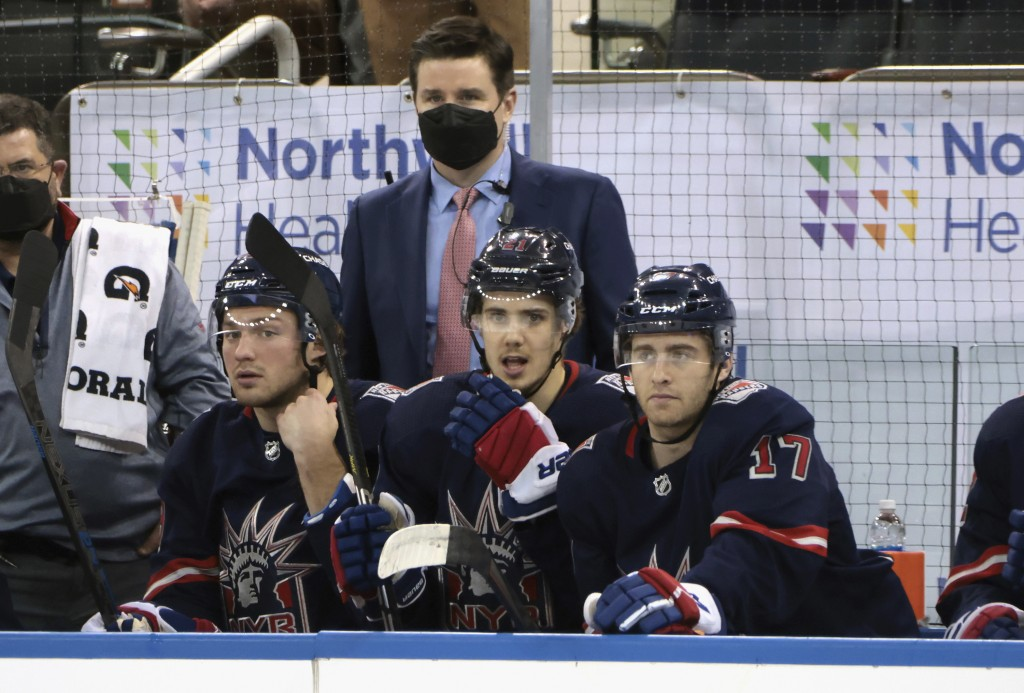 FILE - In this Wednesday, March 17, 2021 file photo, New York Rangers Associate General Manager Chris Drury works the bench during an NHL hockey game ...