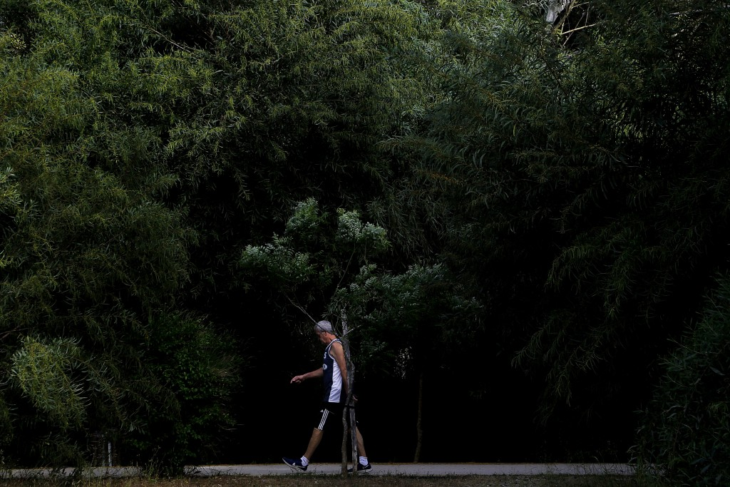 A man walks at a main park amid COVID-19 pandemic restrictions government in central capital Nicosia, Cyprus, Thursday, May 6, 2021.  Cyprus has unvei...