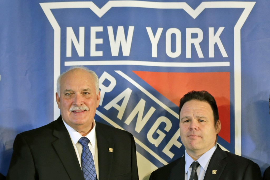 FILE - John Davidson, left, president of the New York Rangers, and Rangers general manager Jeff Gorton pose at a news conference in New York, in this ...