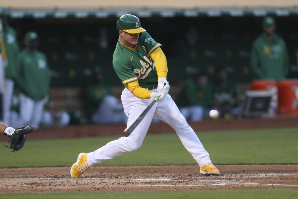 Oakland Athletics' Matt Chapman hits a solo home run against the Toronto Blue Jays during the fourth inning of a baseball game in Oakland, Calif., Wed...