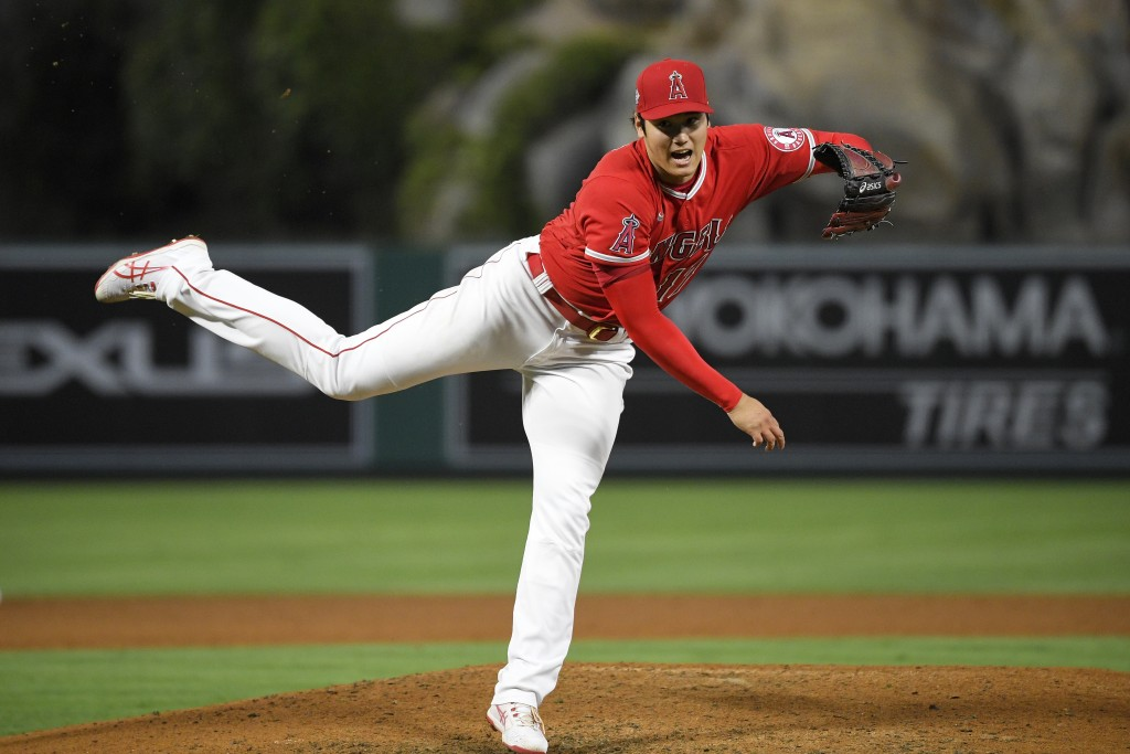Los Angeles Angels starting pitcher Shohei Ohtani throws to the plate during the fifth inning of a baseball game against the Tampa Bay Rays Wednesday,...