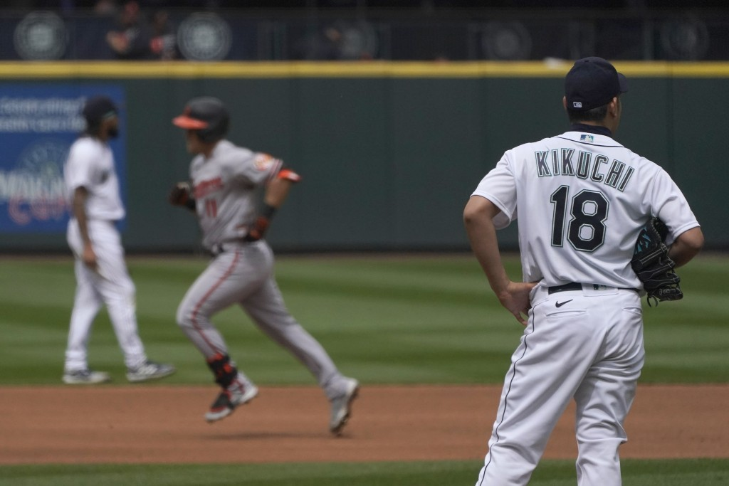 Seattle Mariners starting pitcher Yusei Kikuchi (18) watches as Baltimore Orioles' Pat Valaika rounds the bases after he hit a solo home run in the se...