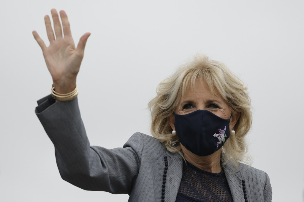 First lady Jill Biden waves as she departs Andrew Air Force Base, Md., Wednesday, May 5, 2021. (Carlos Barria/Pool via AP)