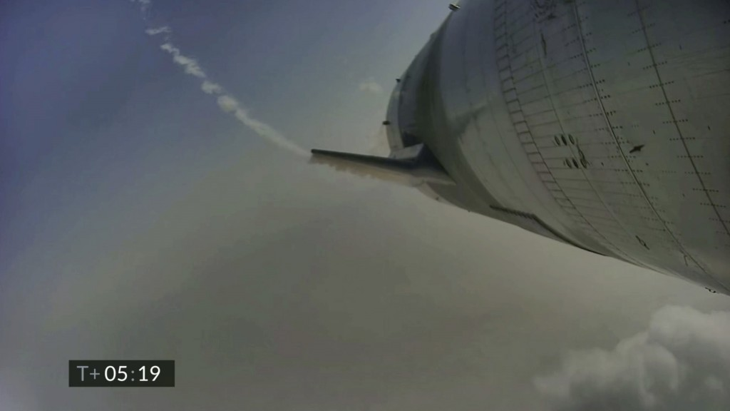 In this image from video made available by SpaceX, a Starship test vehicle descends during a flight test in Boca Chica, Texas on Wednesday, May 5, 202...