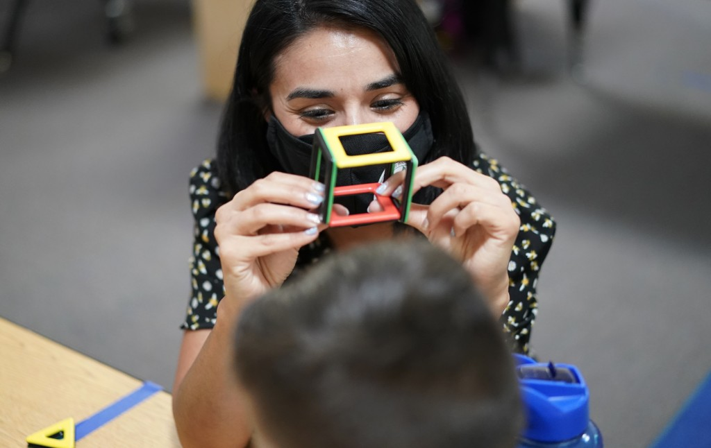 Teacher Juliana Urtubey works with a student in a class at Kermit R Booker Sr Elementary School Wednesday, May 5, 2021, in Las Vegas. Urtubey is the t...
