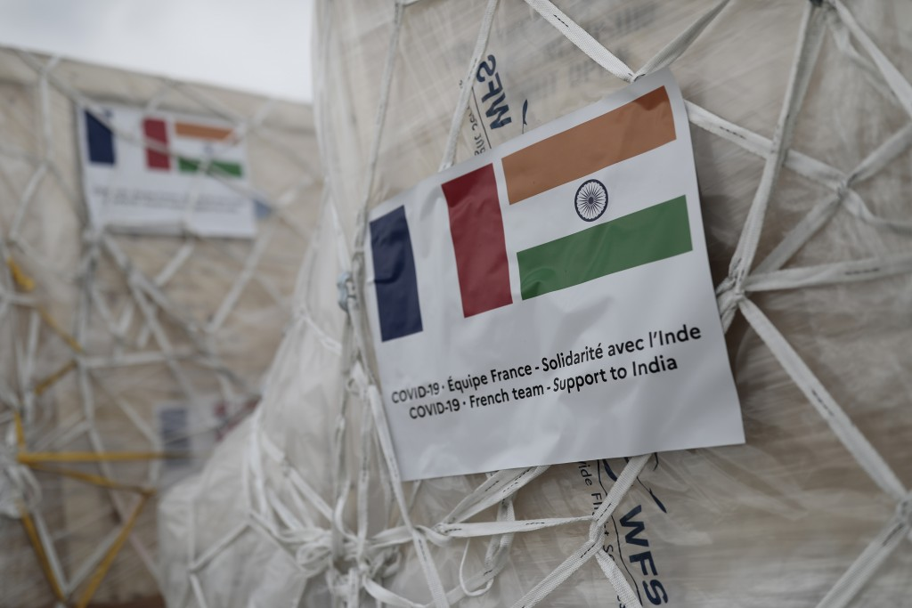 FILE - In this May 1, 2021, file photo, medical supplies to be sent to India are pictured at Roissy airport, north of Paris. India's large diaspora is...