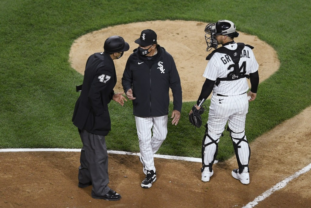 FILE - In this April 12, 2021, file photo, Chicago White Sox manager Tony La Russa, center, argues with home plate umpire Gabe Morales (47) while catc...