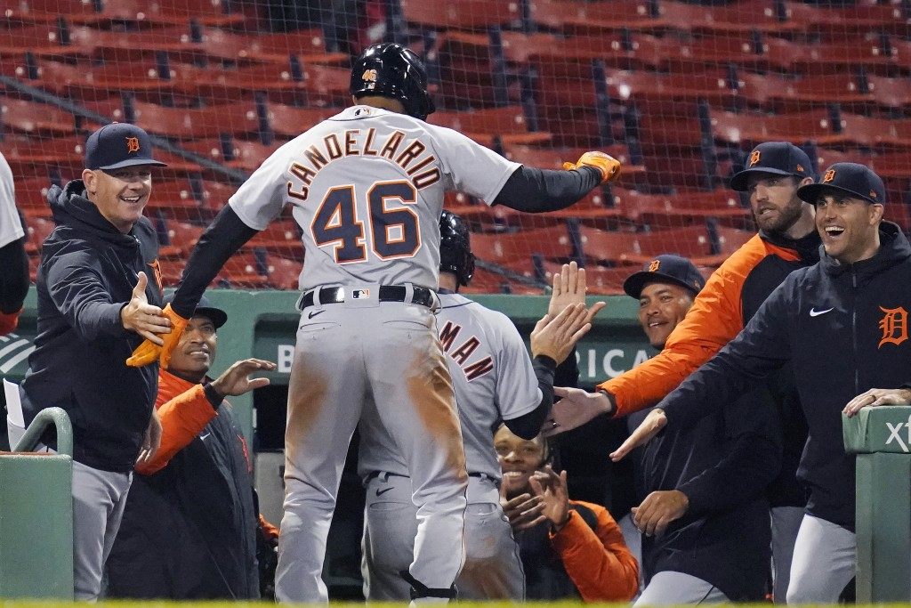 Detroit Tigers' Jeimer Candelario (46) dances on the dugout steps after his three-run home run during the 10th inning of the team's baseball game agai...