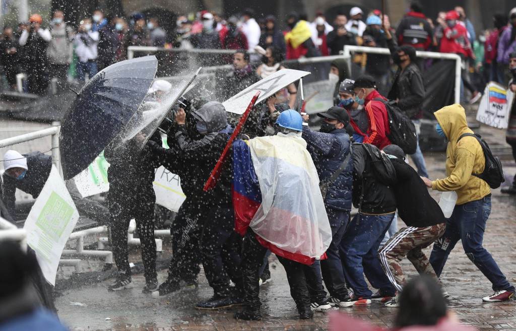 Anti-government protesters clash with police in Bogota, Colombia, Wednesday, May 5, 2021. The protests that began last week over a tax reform proposal...