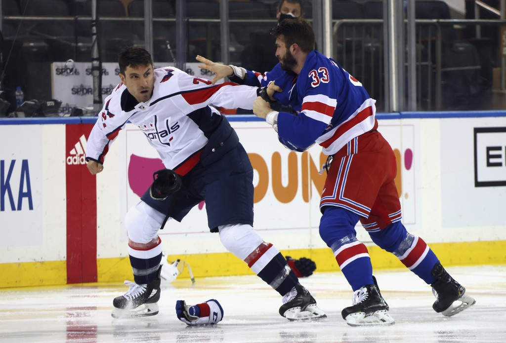 Washington Capitals' Garnet Hathaway (21) fights with New York Rangers' Phillip Di Giuseppe (33) during the first period of an NHL hockey game Wednesd...
