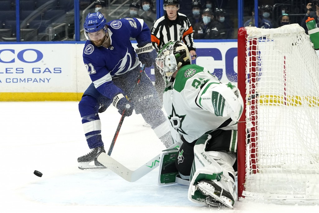 Tampa Bay Lightning center Brayden Point (21) misses a shot in front of Dallas Stars goaltender Jake Oettinger (29) during the second period of an NHL...