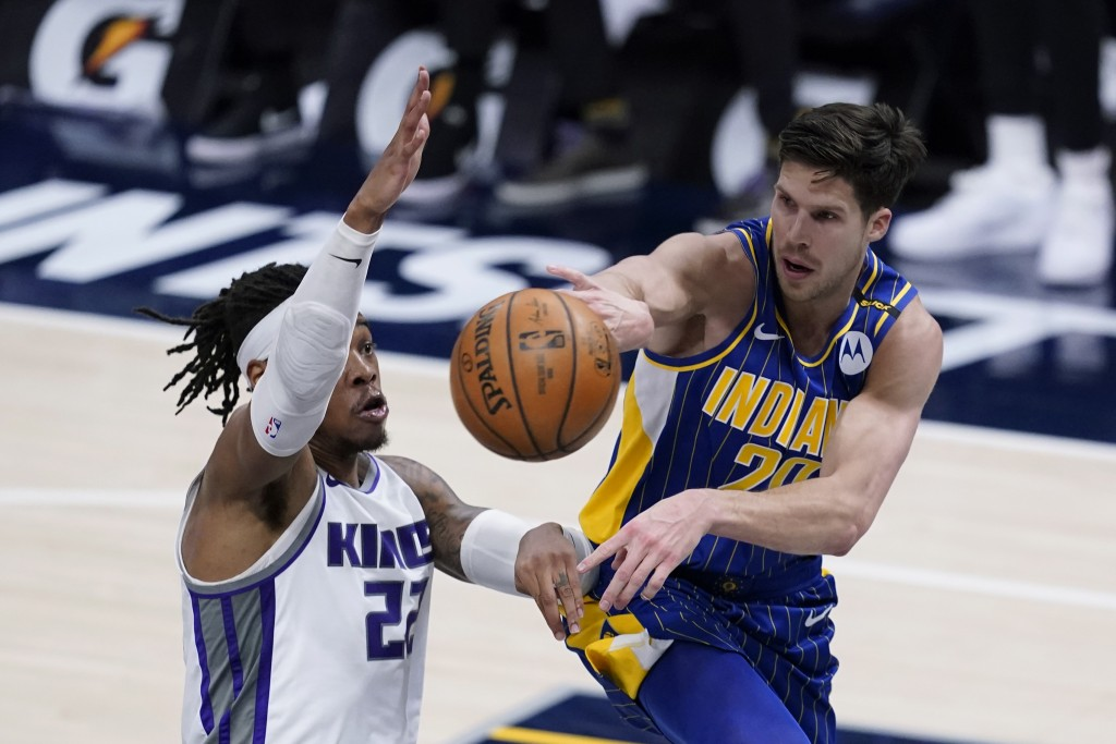 Indiana Pacers' Doug McDermott (20) passes the ball as Sacramento Kings' Richaun Holmes (22) defends during the second half of an NBA basketball game ...