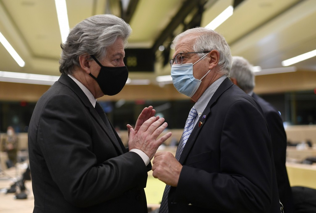 European Commissioner for Internal Market Thierry Breton, left, speaks with European Union foreign policy chief Josep Borrell meeting of EU defense mi...