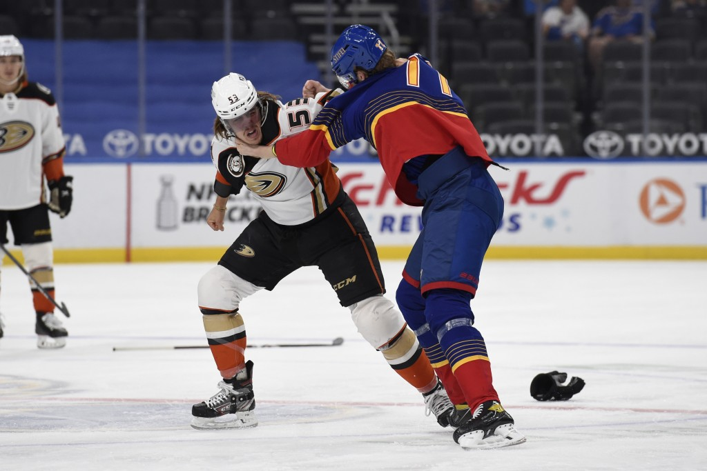 Anaheim Ducks' Max Comtois (53) gets physical with St. Louis Blues' Niko Mikkola (77) during the first period of an NHL hockey game on Wednesday, May ...