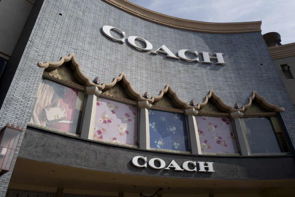 FILE - This May 3, 2019 file photo shows a Coach retail shop at the Citadel Outlets in Commerce, Calif.  Strong sales results from Coach's parent as w...