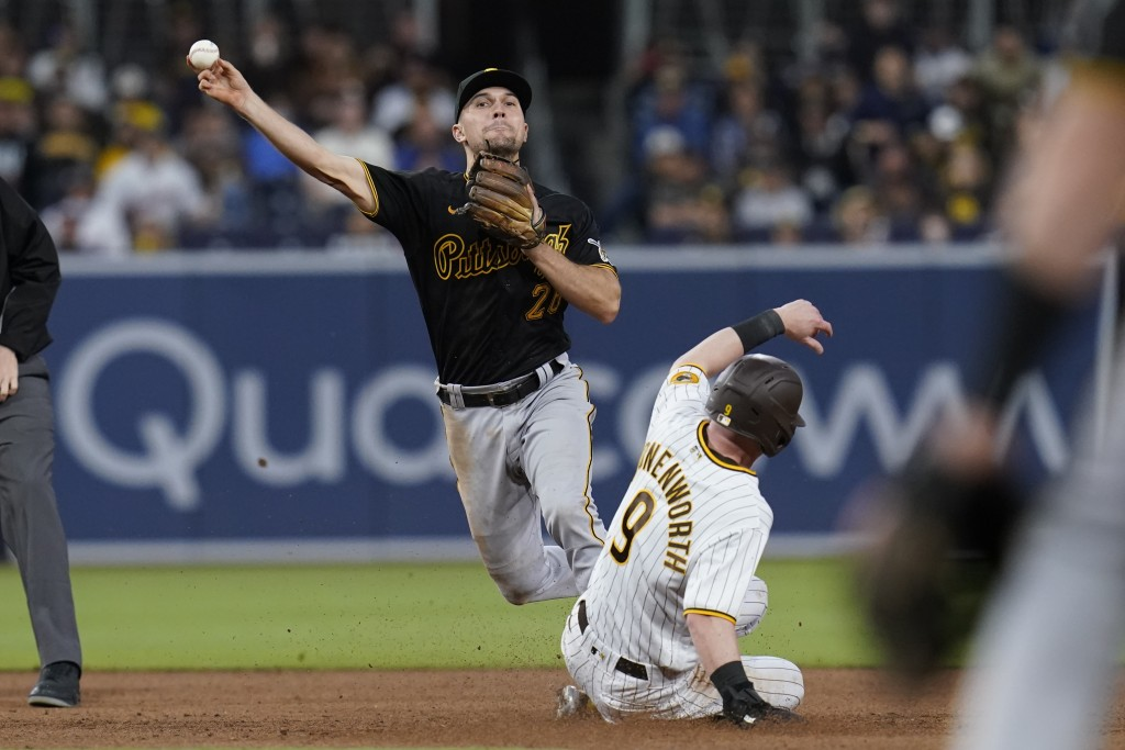 Pittsburgh Pirates second baseman Adam Frazier throws to first to complete the double play as San Diego Padres' Jake Cronenworth slides at second duri...