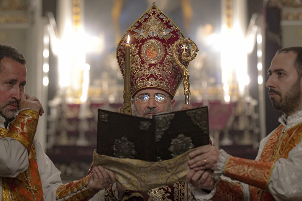Iraq-born Archbishop Datev Hagopian, leads the Easter religious service, at the Armenian Church in Bucharest, Romania, Saturday, May 1, 2021. More tha...