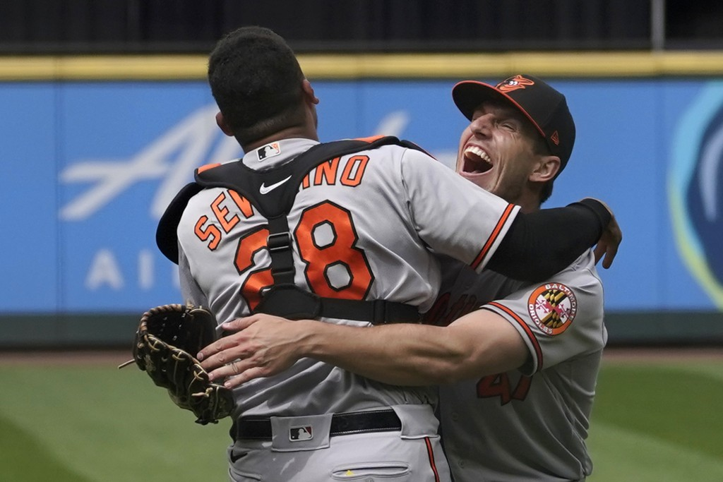 Baltimore Orioles starting pitcher John Means, right, hugs catcher Pedro Severino after Means threw a no-hitter in the team's baseball game against th...