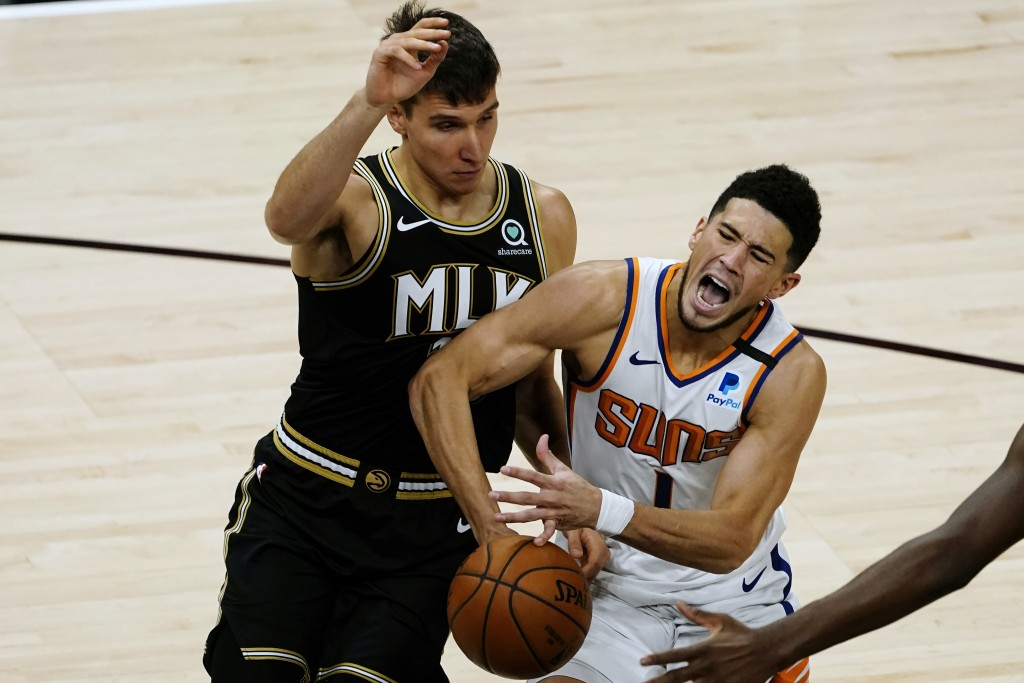 Phoenix Suns guard Devin Booker (1) is fouled by Atlanta Hawks forward Danilo Gallinari (8) in the first half of an NBA basketball game Wednesday, May...
