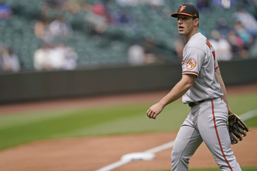 Baltimore Orioles starting pitcher John Means walks off the field after the sixth inning against the Seattle Mariners during a baseball game, Wednesda...