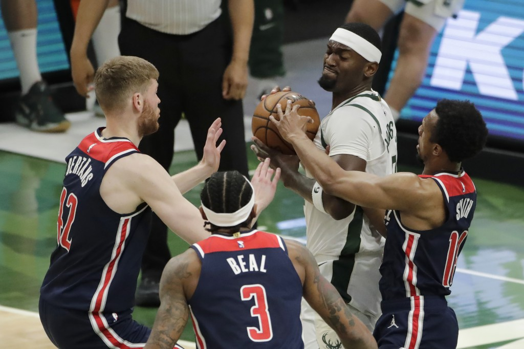 Milwaukee Bucks' Bobby Portis controls the ball while surrounded by Washington Wizards' Davis Bertans, Bradley Beal and Ish Smith, from left, during t...