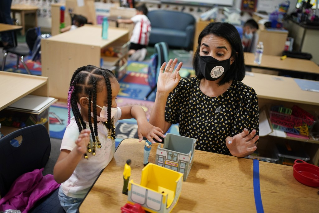 Teacher Juliana Urtubey, right, works with A'Real Wilkerson-Lay in a class at Kermit R Booker Sr Elementary School Wednesday, May 5, 2021, in Las Vega...