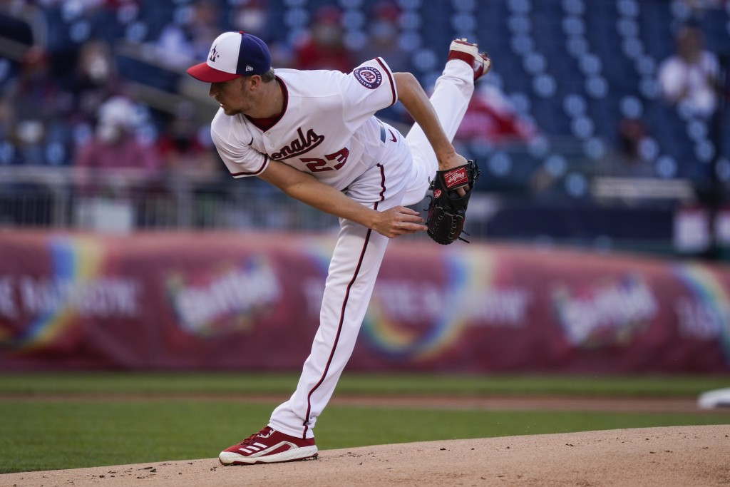 Washington Nationals starting pitcher Erick Fedde watches a throw during the first inning of the team's baseball game against the Atlanta Braves at Na...