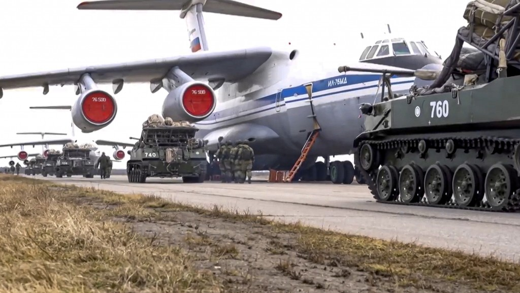 FILE - In this file photo released on Thursday, April 22, 2021 by Russian Defense Ministry Press Service, Russian military vehicles prepare to be load...