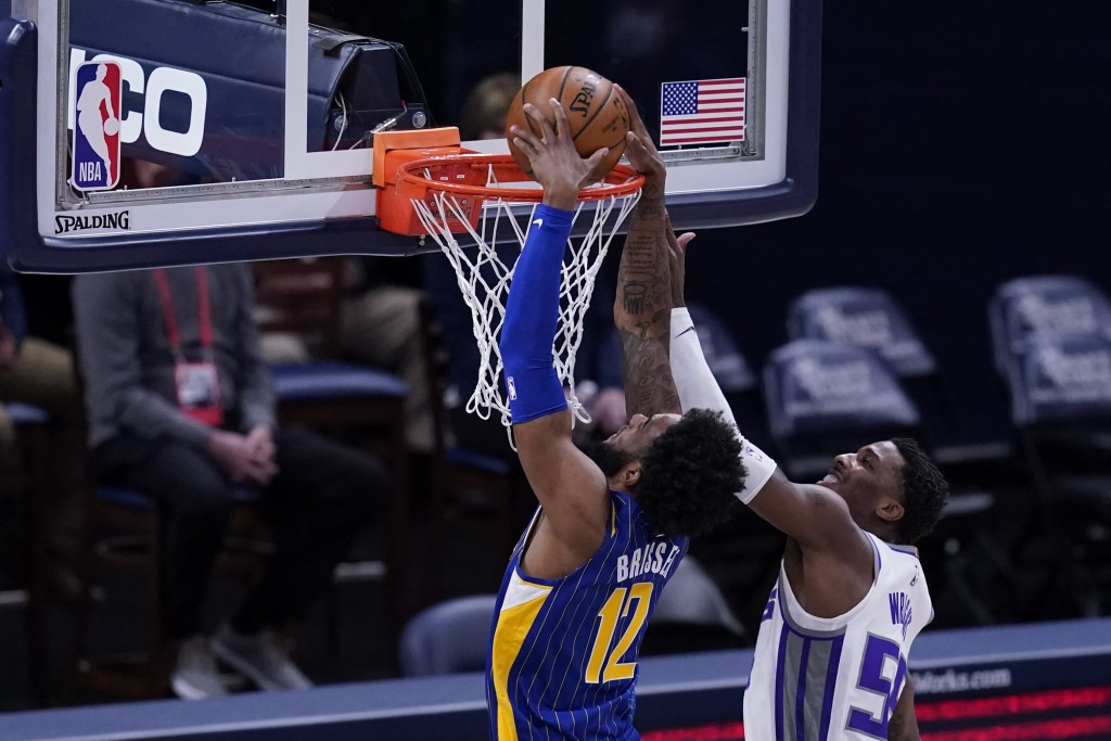Indiana Pacers' Oshae Brissett (12) dunks against Sacramento Kings' Delon Wright (55) during the first half of an NBA basketball game Wednesday, May 5...