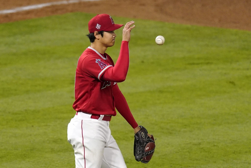 Los Angeles Angels starting pitcher Shohei Ohtani tosses the ball after walking Tampa Bay Rays' Joey Wendle during the sixth inning of a baseball game...