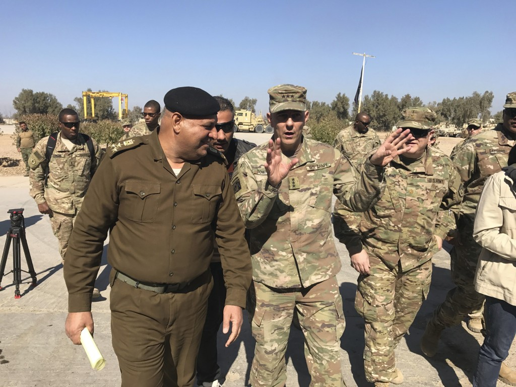 FILE - In this Feb. 8, 2017, file photo, then-Army Lt. Gen. Stephen Townsend talks with an Iraqi officer during a tour north of Baghdad, Iraq. Townsen...