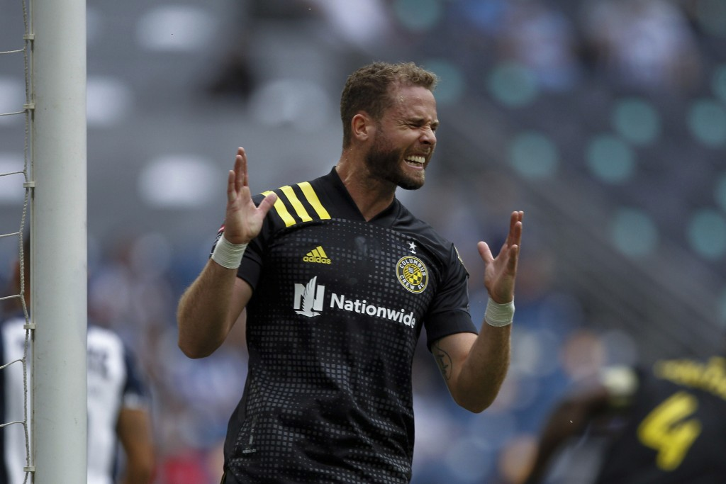 Josh Williams of Unites States' Columbus Crew grimaces after missing a chance to score against Mexico's Monterrey during a Concacaf Champions League s...