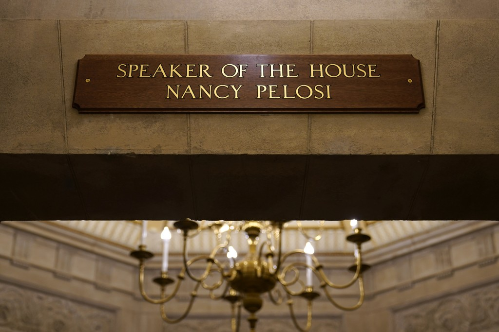 FILE - In this Jan.18, 2021 file photo, a view of the new sign marking the office for House Speaker Nancy Pelosi of Calif., from inside the U.S. Capit...