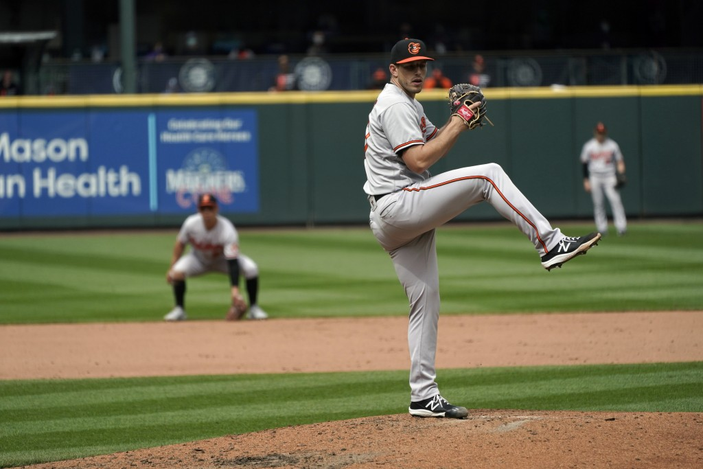 Baltimore Orioles starting pitcher John Means throws against the Seattle Mariners during the eighth inning of a baseball game, Wednesday, May 5, 2021,...