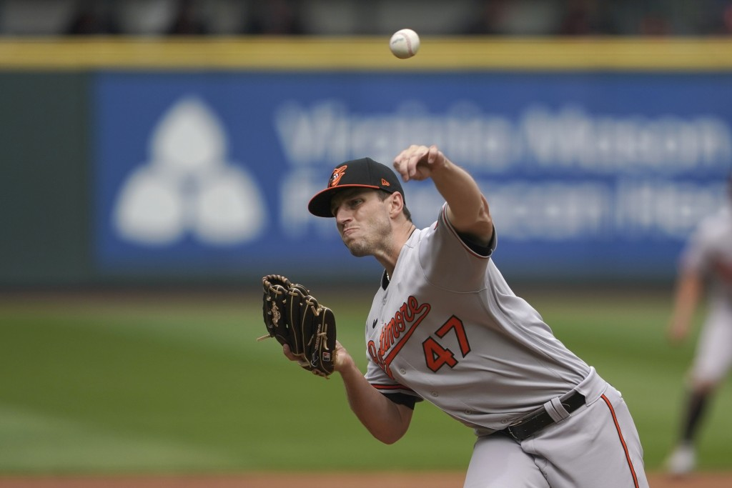 Baltimore Orioles starting pitcher John Means throws against the Seattle Mariners during the fifth inning of a baseball game, Wednesday, May 5, 2021, ...