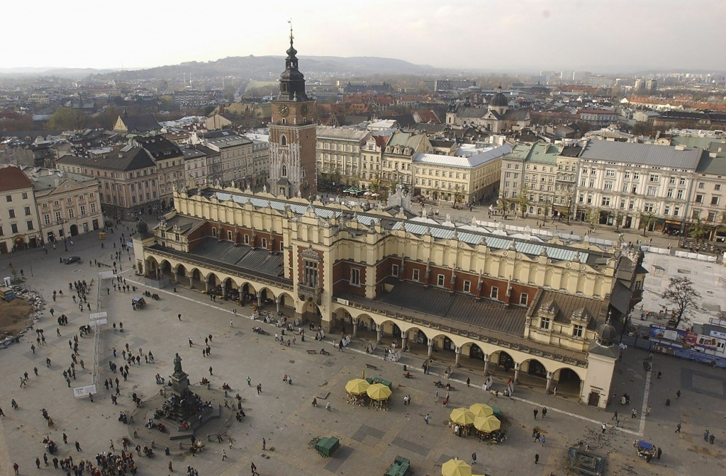 FILE - In this file photo taken on Nov. 3, 2004, A view of the Polish city of Krakow and its roofed cloth market, or Sukiennice, seen from the taller ...