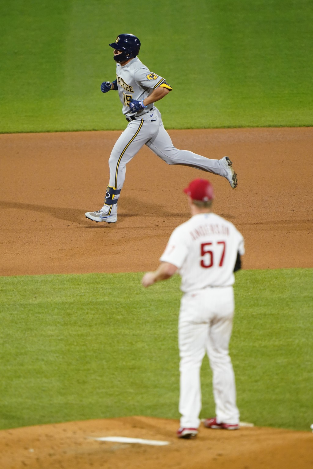 Milwaukee Brewers' Tyrone Taylor, left, rounds the bases after hitting a home run off Philadelphia Phillies pitcher Chase Anderson during the fifth in...
