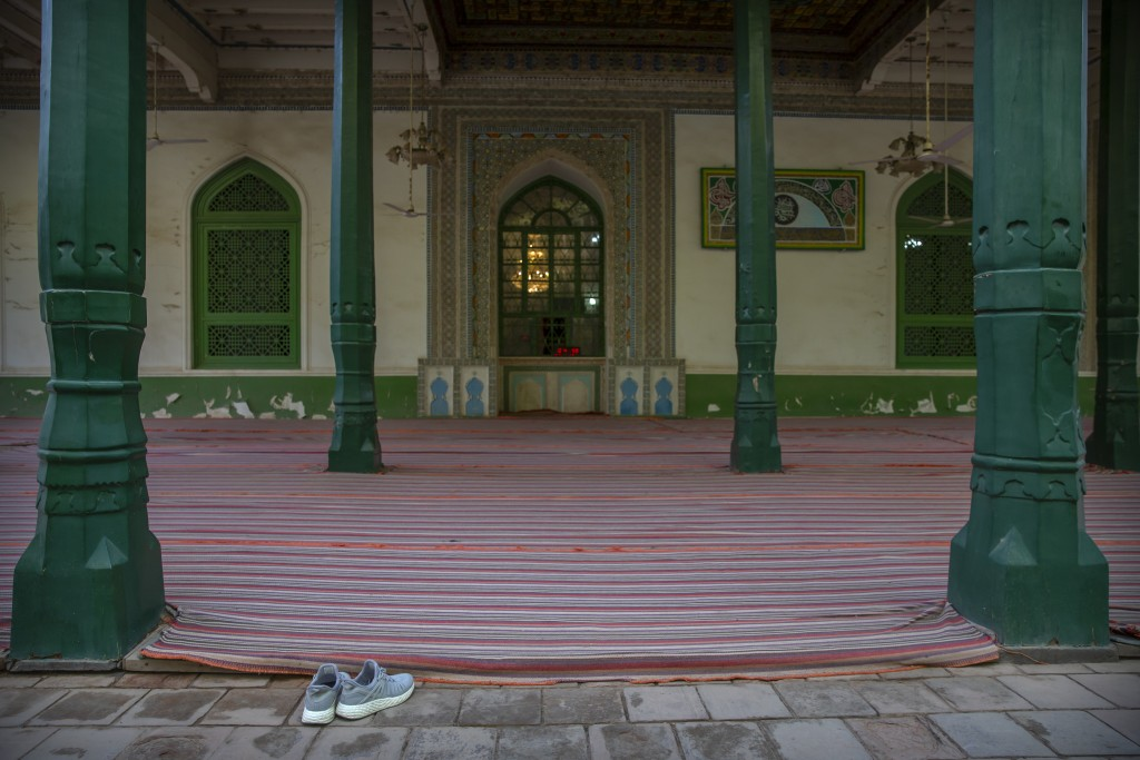 A pair of shoes sits near an outdoor prayer area at the Id Kah Mosque in Kashgar in western China's Xinjiang Uyghur Autonomous Region, as seen during ...
