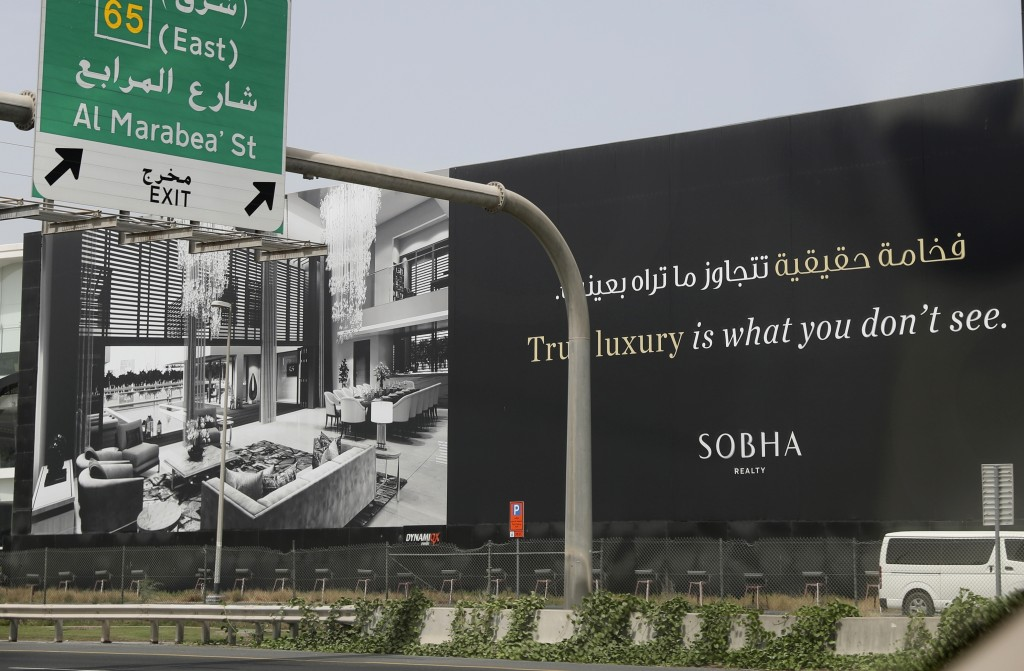 A billboard advertises a luxury residential project along a highway in Dubai, United Arab Emirates, Wednesday, May 5, 2021. Foreign buyers flush with ...