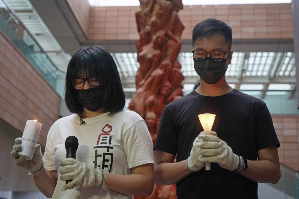 In this Sunday, May 2, 2021, photo, Hong Kong Alliance in Support of Patriotic Democratic Movements of China Vice Chairperson Chow Hang-tung, left, st...